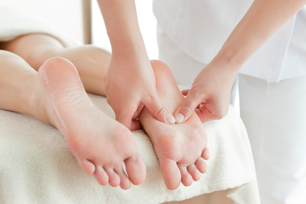 A pair of feet getting massaged