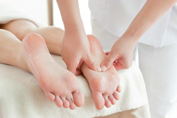 A pair of feet getting massaged